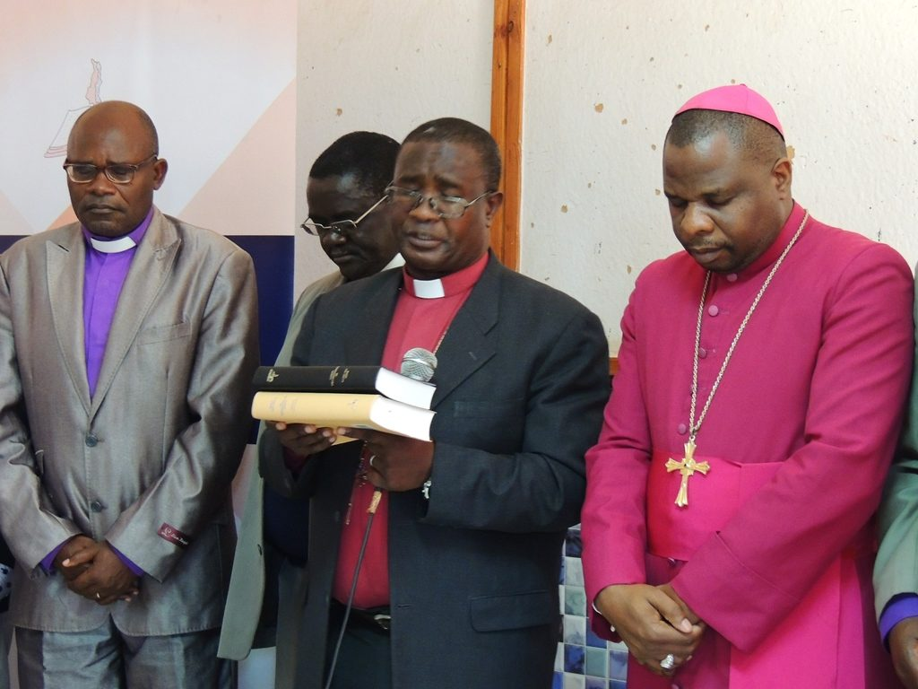 Clergy dedicating the Bibles